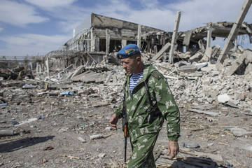 Yakut, an ex-Russian paratrooper, walks at the destroyed airport in Luhansk, eastern Ukraine