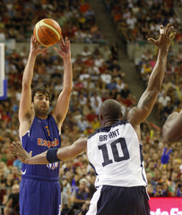 U.S. Olympic basketball player Kobe Bryant challenges Spain's Juan Carlos Navarro during an exhibition game at Palau Sant Jordi in Barcelona, ahead of the 2012 London Olympic Games