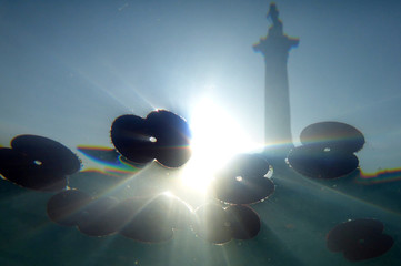 Nelson's Column statue is seen between commemorative poppies floating in a fountain in this photograph taken underwater in Trafalgar Square during an Armistice Day event in London