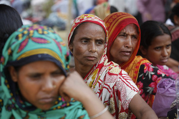 People wait for news of their relatives, garment workers, who are missing after the collapse of Rana Plaza building in Savar