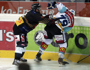 SC Bern's Streit fights for the puck with Rapperswil-Jona Lakers' Riesen during their Swiss Ice Hockey Championships in Bern
