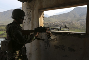 Afghan National Army (ANA) soldier keeps watch at the Forward Base in Nari district near the army outpost in Kunar