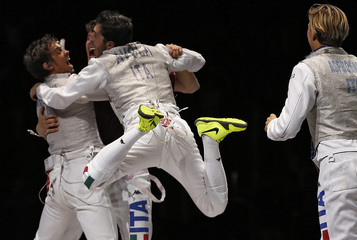 Italy's fencing team members celebrate their victory at the end of the men's foil team gold medal match against Japan at the London 2012 Olympic Games
