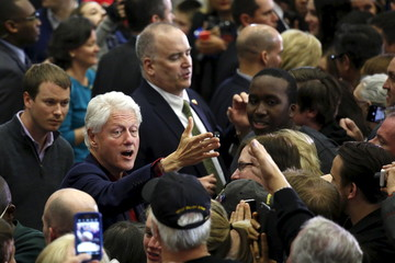 Former U.S. President Bill Clinton greets supporters after a campaign rally led by U.S. Democratic presidential candidate Hillary Clinton in Cedar Rapids, Iowa