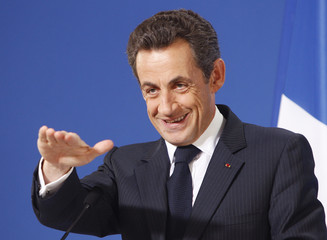 France's President Sarkozy holds a news conference during a EU leaders summit in Brussels