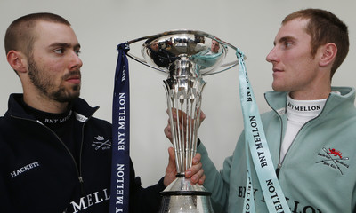 The Oxford and Cambridge crew presidents Alexander Davidson and George Nash pose with The Boat Race Trophy following a news conference in London