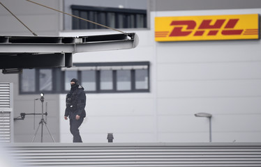 A security officer stays on the roof of the airport building ahead of U.S. President Obama visit to Hanover