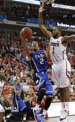 North Carolina State University's Richard Howell stops Duke University's Quinn Cook short of the basket during their NCAA basketball game in Raleigh
