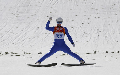 Austria's Klapfer reacts after his jump in the normal hill ski jumping portion of the Nordic Combined individual 10 km event at the Sochi 2014 Winter Olympic Games
