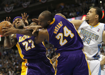 Los Angeles Lakers center Jordan Hall (27) has a shot blocked by Denver Nuggets center JaVale McGee (34) as Lakers guard Kobe Bryant (24) defends in Game 4 of their NBA Western Conference basketball playoffs in Denver