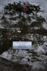 The grave of six-year-old Catherine Hubbard is seen at the St Rose Cemetery, nearly two weeks after a gunman opened fired killing 20 students and six adults at Sandy Hook Elementary School, in Newtown, Connecticut