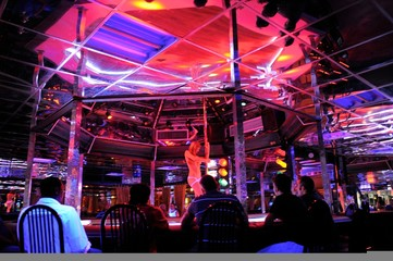 A strip dancer performs for customers at the Mons Venus strip club in Tampa