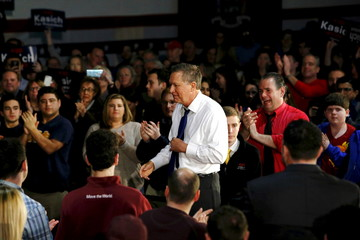 U.S. Republican presidential candidate Kasich shakes hands with supporters after speaking at a town hall meeting in New Rochelle, New York