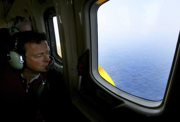BP CEO Tony Hayward looks out of the window of a helicopter as he travels over the Gulf of Mexico