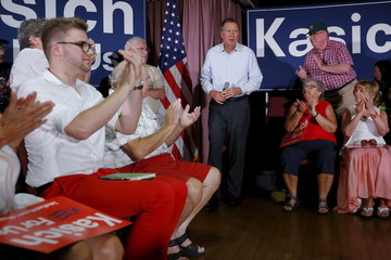 U.S. Republican presidential candidate and Ohio Governor Kasich takes the stage at a campaign town hall meeting in Salem