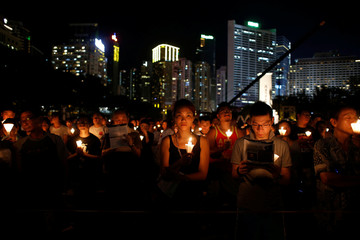 People take park in a candlelight vigil to mark the 27th anniversary of the crackdown of pro-democracy movement at Beijing's Tiananmen Square, in Hong Kong
