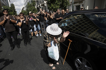 Woman claps her hands during a rally organised by municipal workers in central Athens