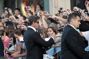 "Stallone signs autographs as he arrives at the premiere of ""The Expendables 2"" at the Grauman's Chinese theatre in Hollywood"