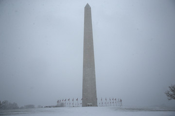 Freshly fallen snow covers the area around the Washington Monument in Washington