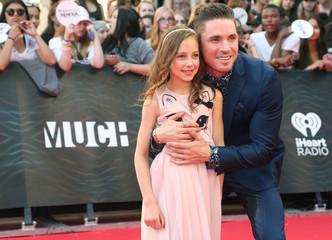 Dancer Blake McGrath and Livi arrive for the iHeartRadio Much Music Video Awards (MMVAs) in Toronto