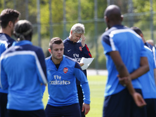 Arsenal manager Arsene Wenger leads a training session at London Colney near London