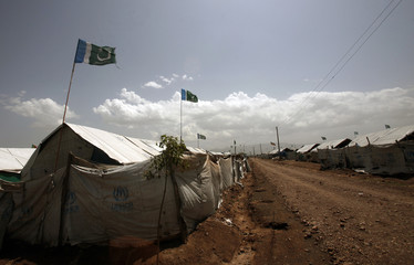 Flags of Jamaat-e-Islami party fly over tents for internally displaced people, who fled military operations in Khyber Agency, at UNHCR Jalozai camp in Pakistan's northwest Khyber-Pakhtunkhwa province camp