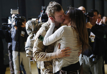 Canadian Army Master Corporal Anthony Alliot kisses Sarah Tooth after arriving from Afghanistan, in Ottawa
