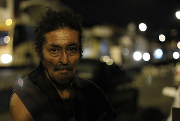 A homeless man waits for food during an event held to celebrate Christmas with the homeless in San Jose