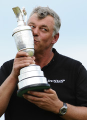 Clarke kisses the Claret Jug after winning the British Open golf championship at Royal St George's in Sandwich