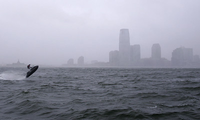 Felquin Piedra rides his personal watercraft in New York Harbor as Hurricane Sandy approaches New York