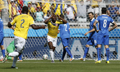 Colombia's Armero celebrates after scoring against Greece during their 2014 World Cup Group C soccer match at the Mineirao stadium in Belo Horizonte