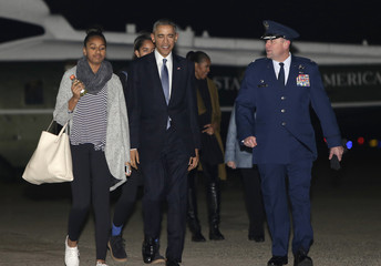President Obama and the first family depart for their Hawaiian holiday vacation from Joint Base Andrews in Maryland