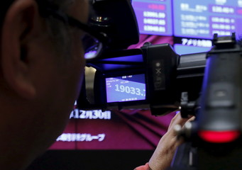 Japan's Nikkei average is seen on a viewfinder of a video camera after a ceremony marking the end of trading in 2015 at the Tokyo Stock Exchange (TSE) in Tokyo