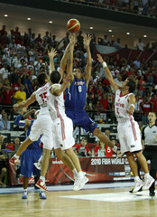 Puerto Rico's Vassallo shoots and misses for win over Turkey as host of defenders crowd around at the end of their FIBA Basketball World Championship game in Ankara
