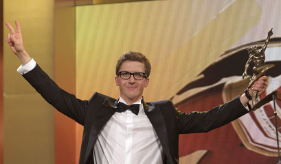"""Swiss skijumper and four time Olympic gold medalist Simon Ammann speaks after receiving the """"Athlete of the Year Award"""" during the Swiss Sports Awards gala in Zurich"""