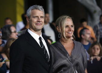 """Director of the movie Burger and his wife Diana pose at the premiere of """"Divergent"""" in Los Angeles"""