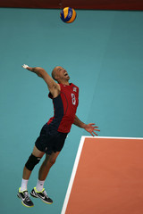 William Priddy of the U.S. serves during their men's Group B volleyball match against Serbia at the London 2012 Olympic Games at Earls Court