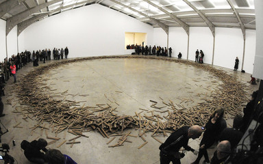 The installation  'Untitled # 155'  consisting of 10,000 wooden slats is seen after being kicked down by its creator, Britsh artist Aeneas Wilder, in a performance at the Yorkshire sculpture park near Barnsley