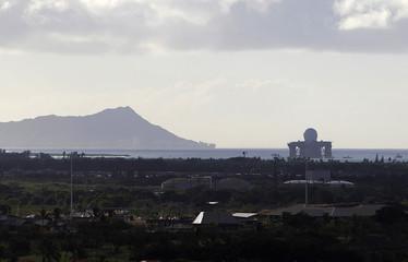 The U.S. Navy Sea based X Band radar leaves Pearl Harbor as a hurricane and a tropical storm approach the Hawaiian islands, in Honolulu