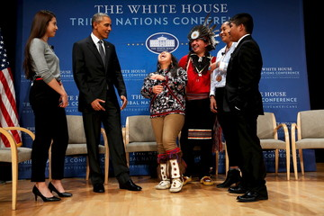 Obama gets a laugh out of young Native Americans after taking part in the annual White House Tribal Nations Conference in Washington