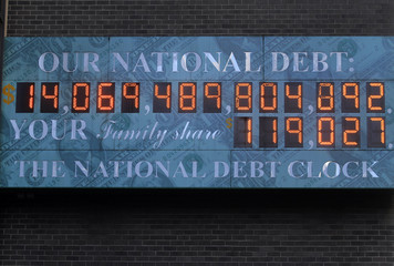 The National Debt Clock hangs from a building near Times Square in New York