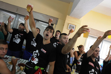 Coal miners toast during the lunch in La Robla after finishing the fourth day walk of the Marcha Negra from Mieres to Madrid