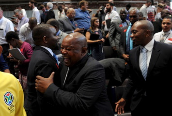 Lekota of the opposition party, COPE celebrates with deputy public protector after South Africa's constitutional court ordered President Jacob Zuma to pay back some of the $16 million of state money spent upgrading his private home in Johannesburg