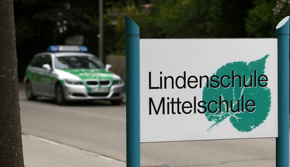 A police car stands in front of the Lindenschule secondary school in Memmingen near Kempten