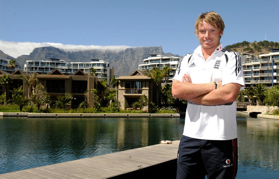 Bell poses for photographers at the team hotel with Table Mountain in the background in Cape Town