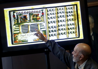 Matos Moctezuma, an archaeologist from Mexico's National Institute of Anthropology and History points to a drawing of a trophy rack for sacrificed human skulls, during a news conference at the Anthropology Museum in Mexico City