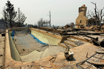 A swimming pool and a chimney remain at the site of a destroyed house after the Soberanes Fire burned through the Palo Colorado area, north of Big Sur, California