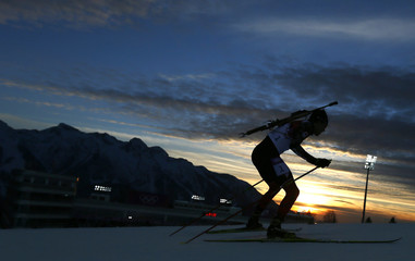 Canda's Smith skis during the men's biathlon 10 km sprint event at the Sochi 2014 Winter Olympics in Rosa Khutor