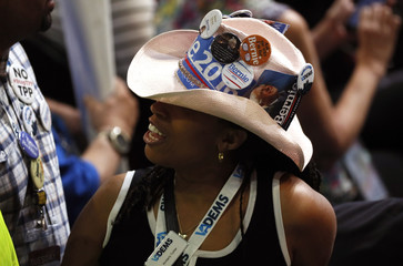 A supporter of former Democratic U.S. presidential candidate Sanders wears a hat adorned with political buttons at the Democratic National Convention in Philadelphia