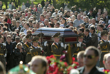 Belarussian soldiers from a guard of honour carry the coffin with the remains of Salei during his funeral in Minsk